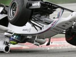 Felipe Massa is turned upside down as Brazilian crashes out of German Grand Prix after collision with Kevin Magnussen